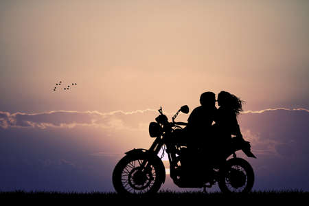 girls kissing: couple kissing on motorbike Stock Photo