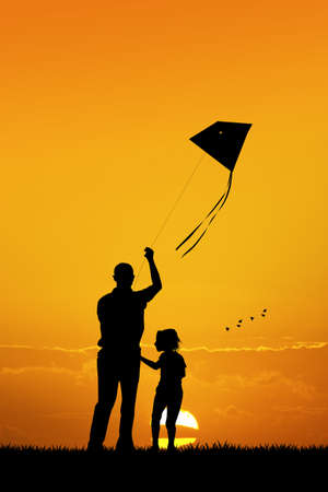 happiness people silhouette on the sunset: father and son with kite at sunset