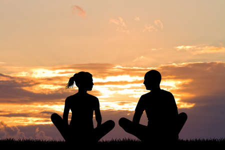 yoga sunset: yoga couple silhouette at sunset