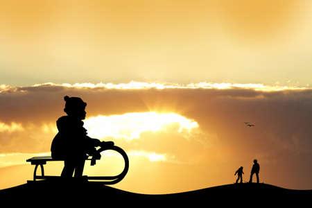 ski pass: child on sleigh at sunset