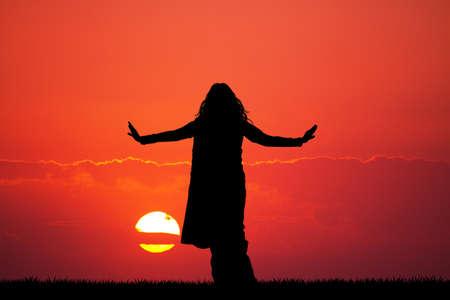 Indian woman dancing at sunset