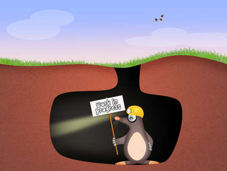animal den: mole digs hole Stock Photo