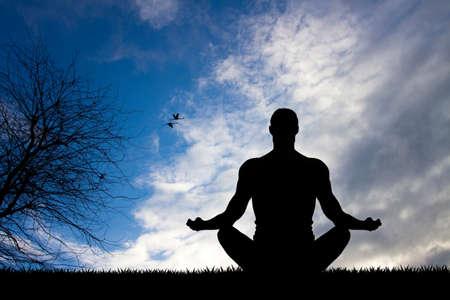 meditation man: man doing yoga silhouette Stock Photo