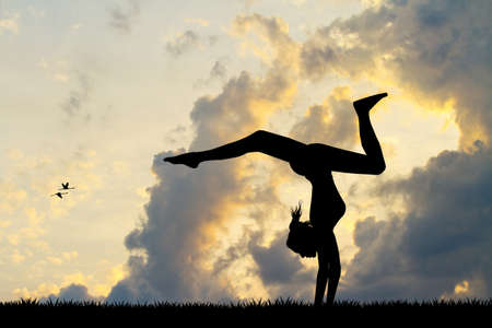 contortion: Girl does contortion at sunset