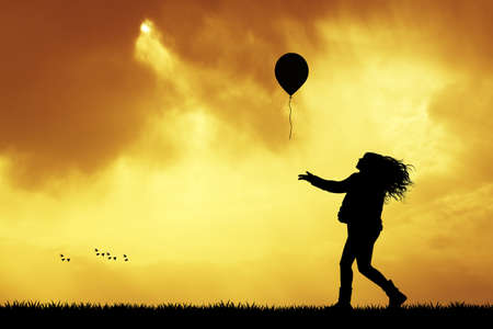 carefree: girl with balloon at sunset