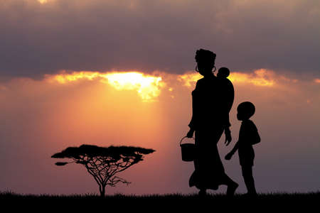 reflection of life: African woman and son at sunset