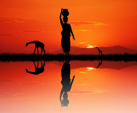reflection of life: African woman carrying water at sunset Stock Photo