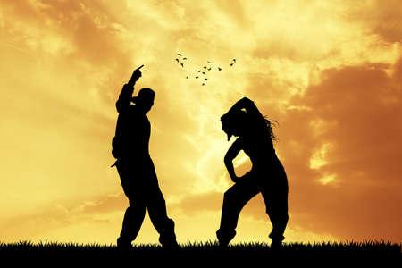 choreography: couple dancing hip hop at sunset Stock Photo
