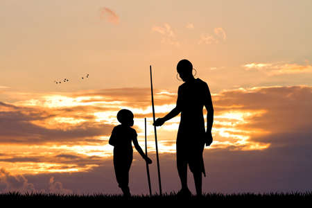 masai: African man and son at sunset Stock Photo
