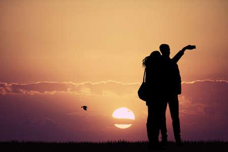 woman cellphone: snaps selfie at sunset