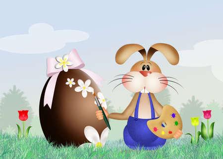 decorates: Rabbit decorates Easter egg Stock Photo