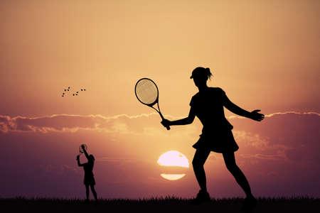 tourney: girl playing tennis at sunset Stock Photo