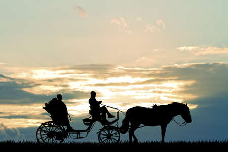 ride: couple on carriage ride at sunset