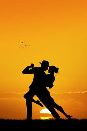 nude outdoors: couple dancing tango at sunset