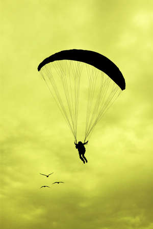 paragliding: paragliding silhouette at sunset Stock Photo