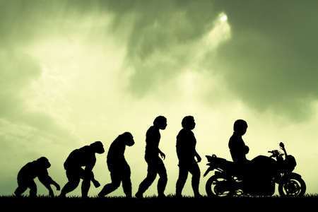 human evolution: human evolution with motorcycle Stock Photo