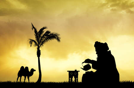 bedouin: Moroccan men drinking tea at sunset