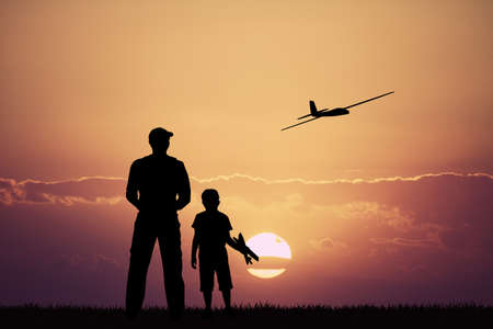 controlled: remote controlled airplanes at sunset Stock Photo