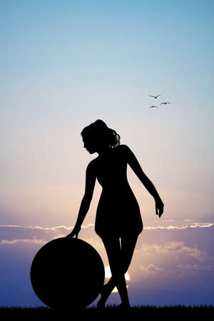 pilates ball: girl with pilates ball at sunset