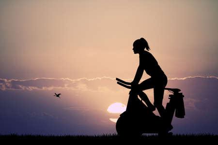 training wheels: girl with cyclette at sunset