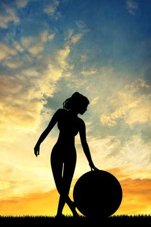 pilates ball: pilates at sunset Stock Photo