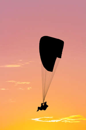 paragliding: during paragliding silhouette at sunset