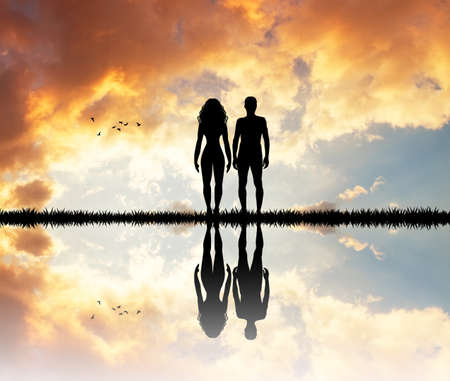 girls kissing: couple silhouette at sunset