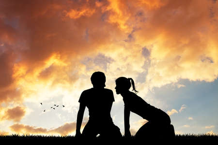 girls kissing: couple kissing at sunset Stock Photo