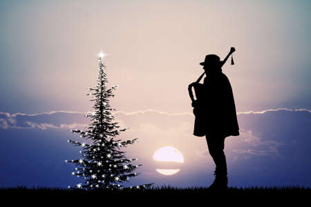 pipers: man plays the bagpipes at Christmas Stock Photo