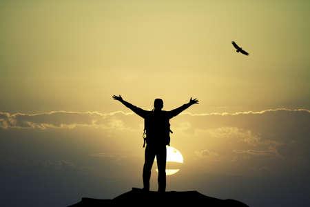 adrenalin: man on mountain at sunset