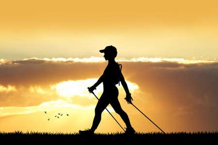 nordic walking at sunset Stock Photo