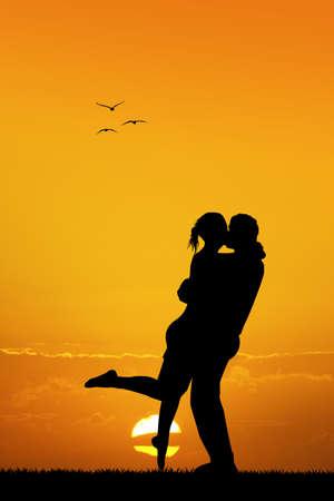 innamorati che si baciano: coppia che si bacia al tramonto