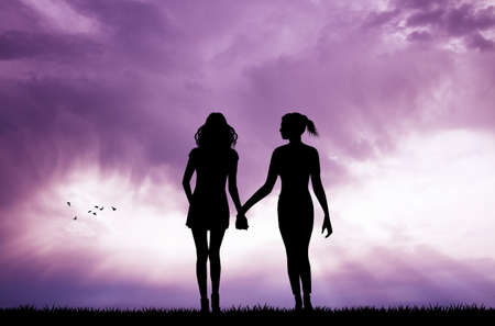 sexual orientation: pair of women at sunset Stock Photo
