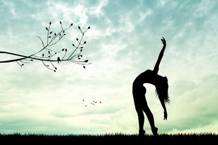 girl dancing at sunset Stock Photo