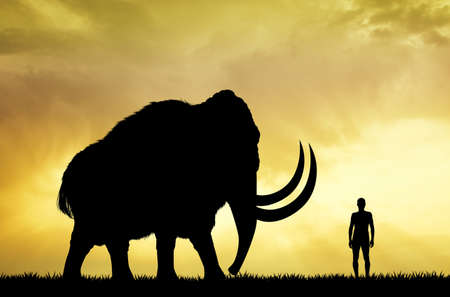 paleolithic: mammoth and man at sunset