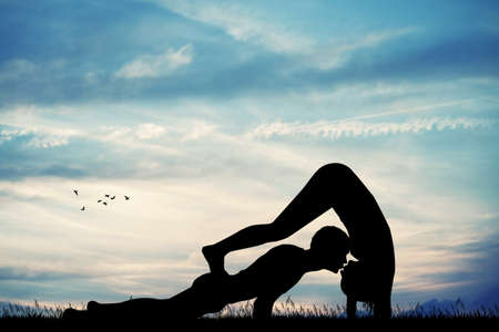 couple doing yoga pose Stock Photo