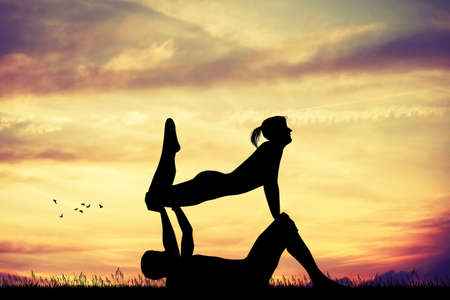 chi: couple doing yoga pose Stock Photo
