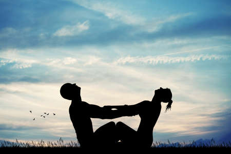 couple makes dawn yoga Stock Photo