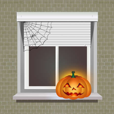 Halloween pumpkin on the window