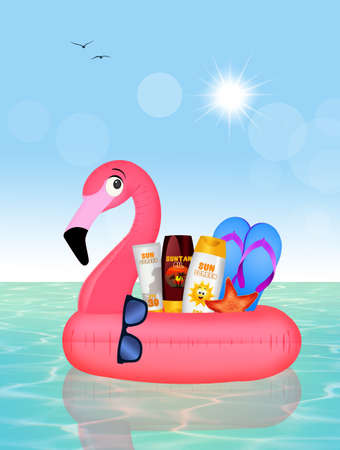 Inflatable pink flamingo with summer objects Stock Photo