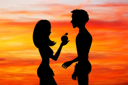 Adam and Eve with the fruit of sin at sunset Stok Fotoğraf - 85809204