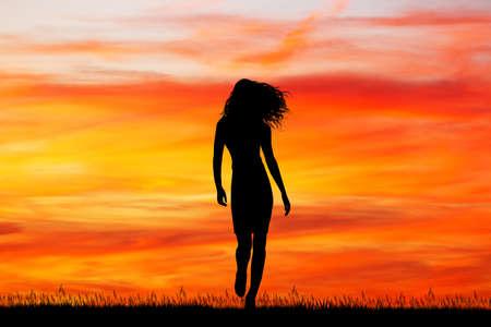 beautiful girl walking at sunset