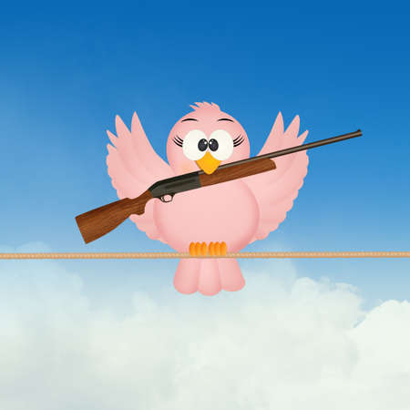 bird with hunting rifle Stock Photo
