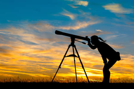 girl and telescope at sunset Stok Fotoğraf