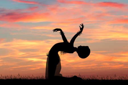 Aziatische danser bij zonsondergang