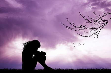 melancholic girl at sunset