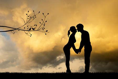 couple kissing at sunset Reklamní fotografie