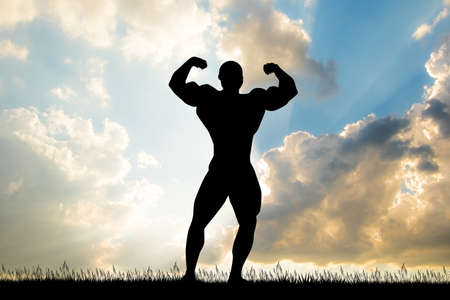 bodybuilder silhouette at sunset
