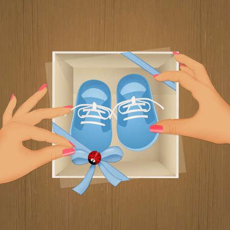 선물 상자에 파란색 아기 신발