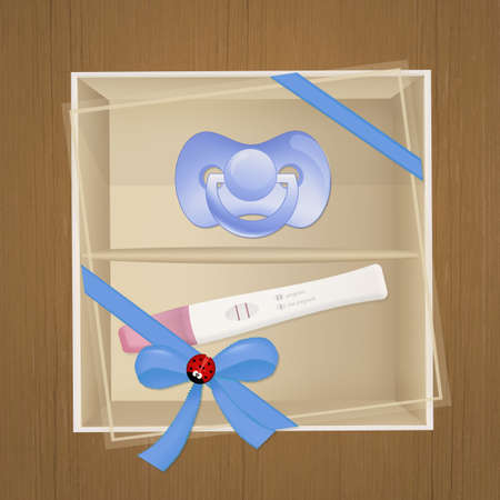 pacifier and pregnancy test in the box Stock Photo